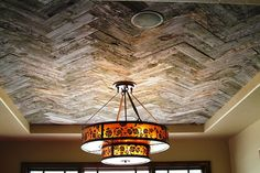Doing this in our light cove in entry way using pallets sitting on side of house- herringbone ceiling reclaimed wood!