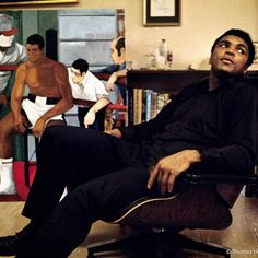 Remembering The Greatest. @muhammadali at home in an #Eames Lounge Chair, 1970. Image: @thomashoepker / @magnumphotos