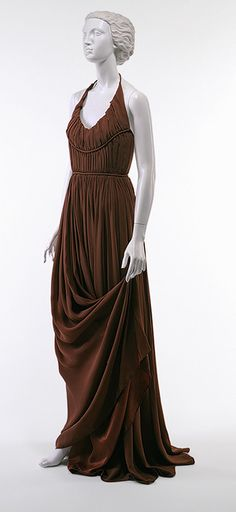 Evening gown, 1949  Edward Molyneux (French, born Britain, 1891–1974)  Mauve acetate satin-backed crepe;    pleated and girdled midriff;       replicated the fluted neckline seen on many Greek and Roman statues.