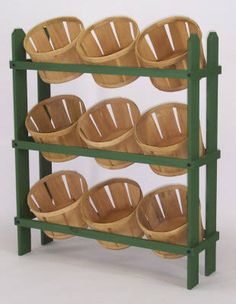 "Basket Display | Wood Produce Display Rack ""Allow 2-3 Weeks Production Time - NO RUSH ORDERS"" When it comes to basket displays, you won't find a finer choice than this wooden basket rack. Wood display racks can be used to display snacks, larger candies, produce, and other retail items. This is one popular, money making display that you won't want to do without. Customers naturally gravitate to engaging wooden produce racks and tend to purchase items placed within."