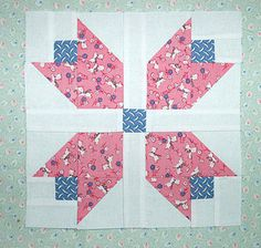 Pieced Tulip Block with 1930's era reproduction fabrics.