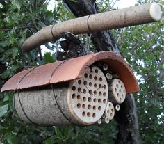 Made of beautiful natural materials with durable fired clay roof to keep the rain out. This type of mason bee house has the prescribed 6 inch