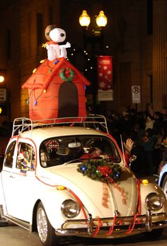 Snoopy makes a parade appearance atop a Volkswagen Beetle. - The 2008 WIVK/Fowler's Christmas Parade