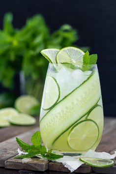A delicious summer time cocktail that's light and refreshing. This Gin Cucumber Cooler can be made with mint or basil for a tasty variation.