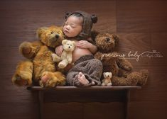 gorgeous African American newborn baby boy dressed like a bear with bear hat sitting on shelf with bears. Precious Baby Photography Angela Forker unique Fort Wayne New Haven Indiana  funny cute adorable