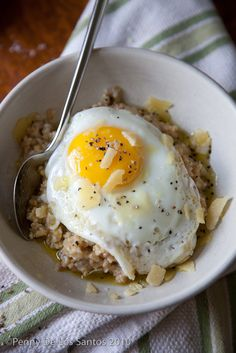 Savory, cheesy oatmeal topped with an egg