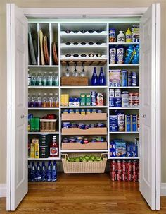 Walk in pantry. Like the fact that this is a large closet which is the space I am working with. Could do without the wine glass holder. Love the upper left corner racks for baking sheets and such. Good base concept.