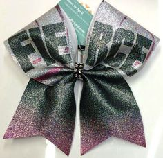 Bows by April - Silver Black and Purple Glitter FIERCE Cheer Bow, $18.00 (http://www.bowsbyapril.com/silver-black-and-purple-glitter-fierce-cheer-bow/)