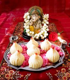 Coconut Rose Modak-Stuffed Dumplings made with coconut and condensed milk