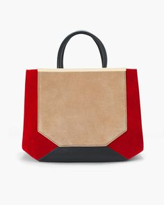 We challenged our design team to incorporate all of our seasonal colors into our handbag collection. We are pleased to present you with the very definition of arm candy. This colorblock confection dons luxurious suede panels, dyed in rich warm tones.