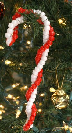 Kids love beading! Turn that fun into a quick and easy craft that can be used as a candy cane ornament or a candy cane bracelet.