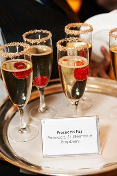 Prosecco + Raspberries + Gold Sugar-Rimmed Glasses | Photo: KingenSmith. Read More: https://www.insideweddings.com/weddings/modern-wedding-with-soft-color-palette-and-personalized-details/792/