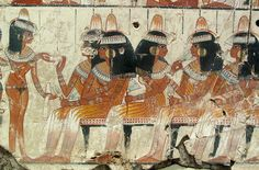 A painting of a feast for Nebamun to enjoy in the afterlife.  Important female guests sit and talk while a servant girl offers refreshment. The ladies wear lumps of scented fat on their elaborate woolen wigs to help keep them cool.  From the wall paintings of the tomb of Nebamun, a wealthy accountant in the Temple of Amun at Thebes circa 1350BC.  British Museum, London