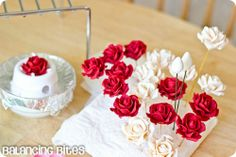 How to make small gumpaste roses (18).  I don't have to make my own cupcakes, but if you're making you're own cake, here is a tutorial on gum paste roses