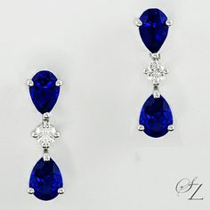 "Intricate and alluring. These lovely Tanzanite and Diamond stud earrings are very becoming. Two pairs of rich ""royal blue'' Tanzanite pears coupled together by a sparkling Diamond brilliant."