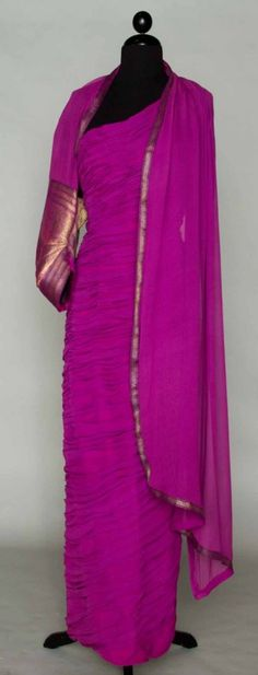 India inspired evening gown, Magenta chiffon, single-shoulder sheath covered in tacked ruching, long narrow chiffon stole w/ metallic sari brocade formed into a single fitted sleeve, 1958