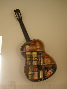 Repurposed guitar as a spice rack for the kitchen