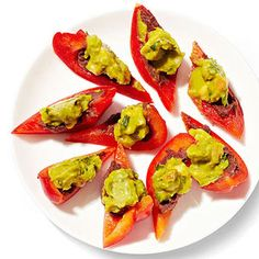 Red bell peppers with black refried beans and @Hassavocados