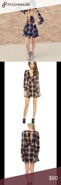"Free People Teen Spirit Plaid Dress Washed Black $128 Free People Teen Spirit Plaid Minidress Washed Black Combo Size 6  Free People Teen Spirit dress Size 6. Long sleeve, low v-neck, lined, and with a lovely slit in the back. True to Size. Measurements taken lying flat are 25"" sleeves, 19"" bust and 33"" in length. Free People Dresses"
