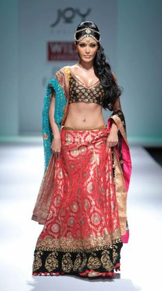 Koena Mitra in beautiful lo waist Lehenga & short low back Choli by Joy Mitra, 2010