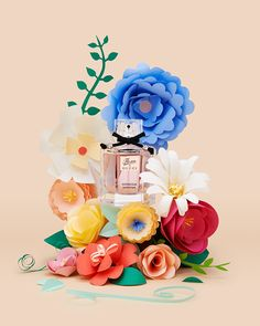 2 images we shot featuring the perfume Flora by Gucci surrounded by papercrafted flowers.
