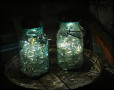 Mason jar..clear stones...solar lights...lovely