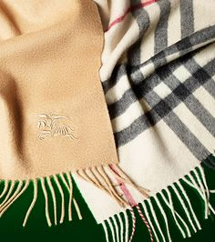 Soft cashmere scarves in iconic check... WANT.  Want so badly!!