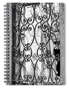 """This 6"""" x 8"""" spiral notebook features the artwork """"Window Grate Bw"""" by Joan Carroll on the cover and includes 120 lined pages for your notes and greatest thoughts."""