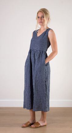 PLEASE SEE OUR NEW SIZE GUIDE. Indigo striped v-neck dress. Pure linen in a ...