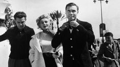 Zsa Zsa Gabor and Porfirio Rubirosa stroll along the French Riviera as they attend the Cannes Film Festival in April 1954