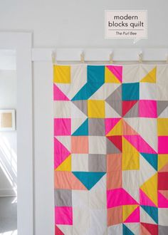 Modern quilt pattern tutorial with blocks and triangles