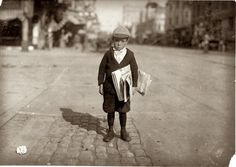 "A 6-year-old newsie who tried to ""short change"" me. Los Angeles, California. May 1915. This kid looks like one of my first graders at work!"
