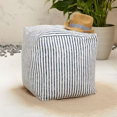 inspired by classic barber pole prints the barber stripe pouf is handwoven by artisans in india outdoor pouf