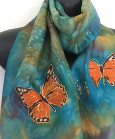 Monarch butterflies on a green and russet background. Lacy Gold, orange, black Butterfly, New Zealand Silk Scarf Hand Painted, Gold wings by KiwiSilks on Etsy Monarch Butterfly, Online Gifts, Butterflies, Jewlery, Scarves, Wings, Crafting, Hand Painted, Gift Ideas