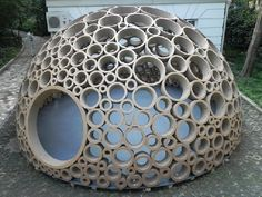Very cool. art installation.. summer time igloo...Wonder if this could be done with kitchen rolls and loo rolls tubes... would take forever... would be a fun project.....  mmh... Wonder if I could use hulu hoops??