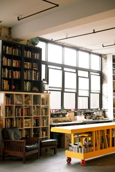 (via Work   Office / studio space) This is an honest-to-goodness work space. Love the organized access to tools on the desk.