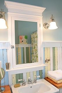 Beach Cottage Decor - multi-colored beadboard- I like the weathered look & the colors are really good. Fun for a beach-y bath. | interiors-designed.com