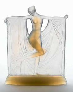 'Suzanne' an Opalescent Glass Figure, design 1925 modelled as a female nude, her outstretched arms draped with flowing fabric 22.5cm high, moulded 'R.Lalique'.