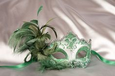 http://www.justposhmasks.com/uploads/products/green_feathered_masquerade_mask_DANI04S.jpg