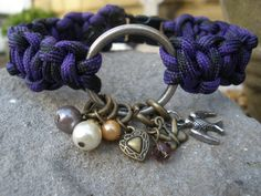 "Items similar to 8"" Purple/Black Split Solomons Heart Weave Paracord Survival Bracelet with Charms on Etsy"