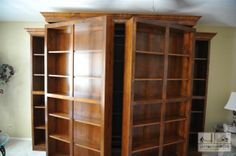swinging bookcases reveal murphy bed