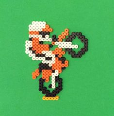 This Excitebike perler bead sprite was inspired by the 1985 Nintendo game, and comes complete with a stand made to resemble the race track. This game was super fun to play and would be a great addition to any gamer or 80s fans collection. If you dont want it on the stand, I offer other options as well. **Bottom row of orange beads is only to fit in stand. Will not be on sprite if stand not ordered.** Measurements: Inspired by the NES game, this sprite is made from over 200 perler beads…