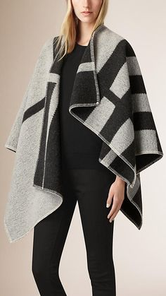 A reversible Burberry blanket poncho crafted in Scotland from wool and cashmere. Monogram yours at Burberry.com