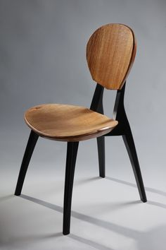 Sonus Guitar Chair - Carved Mahogany with Ebonized Legs. One of the most comfortable wooden chairs in the world, specifically designed for the comfort of guitarists and other musicians.