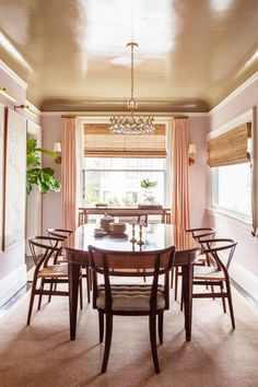 It really doesn't get much prettier than this. The ultimate dining room fit for a princess has a regal vibe courtesy of that super-chic metallic gold ceiling.