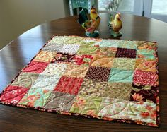 Patchwork Quilted Table Runner is soft warm colors by Mountain Quiltworks