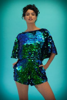 5091ff68d4 Iridescent sequins hand-stitched onto a fine woven rayon voile base. Hidden  zip at the back