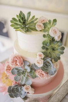 In love with this 3 tier white and pink buttercream cake with its' cascading succulents, roses and ranunculus ~ we ❤ this! moncheribridals.com
