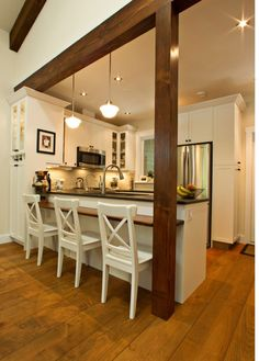 My full on kitchen remodel idea: Opening the arch up between the kitchen and the living room. Adding a eat in bar height or table height area. Build in storage. And in-island stove will sit in front of guests for a presentation style of cooking. Change counters to butcher block. Add dishwasher.