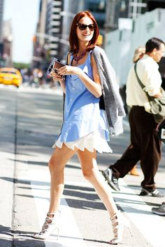 2009: Taylor Tomasi Hill Taylor Tomasi Hill made her first street style appearance in 2006, when Scott Schuman mentioned her flame-hued hair on The Sartorialist. In the years following, she turned that hair into her calling card, but became equally known for her collection of Comme des Garçons, Sacai, and Junya Watanabe.